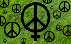 Green grass with women's symbol and peace signs.