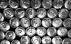Pop tops of many soda cans stacked together.