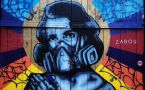Graffitti painting of woman in gas mask