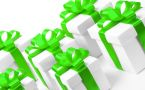 Several white gift boxes tied in bright green bows