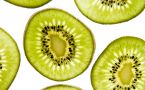 Thin cross section slices of kiwi fruit