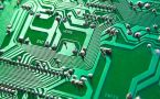 Close up of green motherboard and circuits from computer.