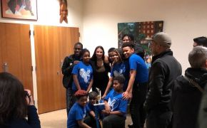 Alexandra Ocasio-Cortez with group of young people.