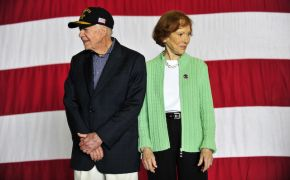 Jimmy and Rosalynn Carter standing in front of American flag