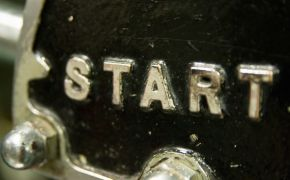 word START in metal letters