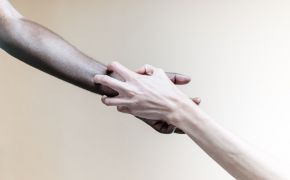 Man's and woman's hands reaching out to grab one another