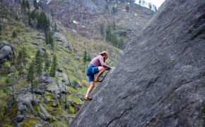 Man rock climbing alone with ropes