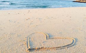 Heart drawn in sand at the beach