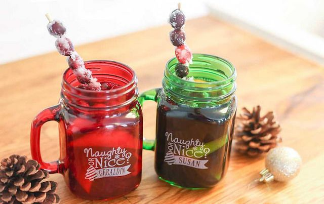 Red and green cocktail mugs say NAUGHTY and NICE