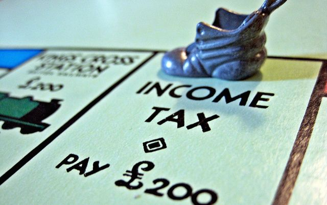 """Monopoly board """"Income Tax"""" space with boot"""