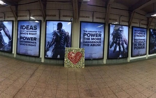 Port Authority Terminal with violent posters and heart mosaic.