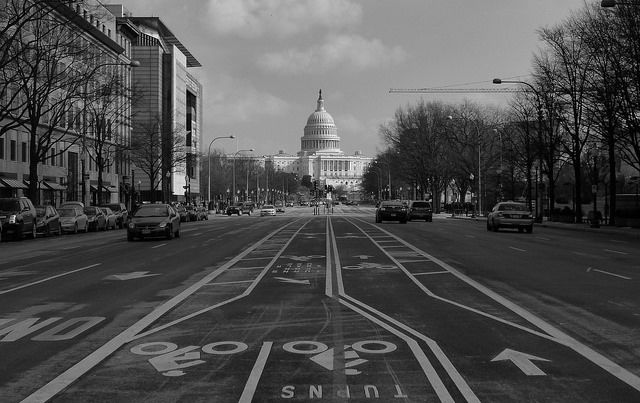 Capitol building in Washington DC black and white at end of street.