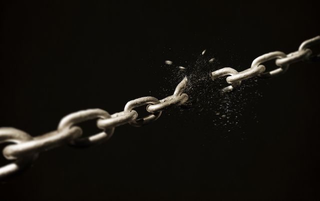 Metal chain breaking apart at a link