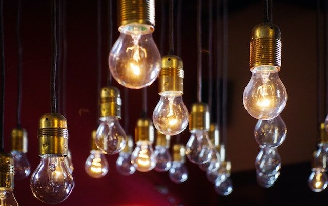 Multiple Edison bulbs hanging in the dark.