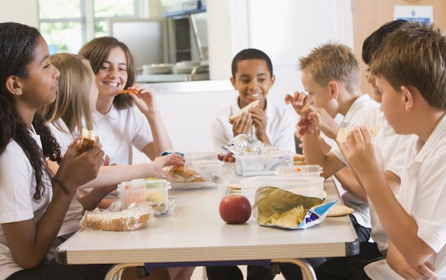 School children eating lunch in cafeteria