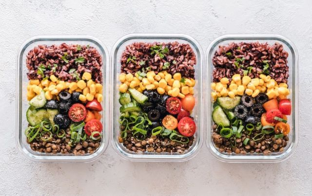 Three containers of combined plant proteins in vegetarian meals.