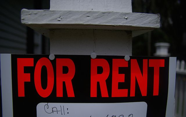 FOR RENT sign tacked to post