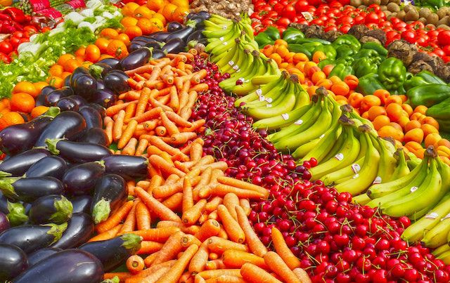 long rows of many fruits and vegetables