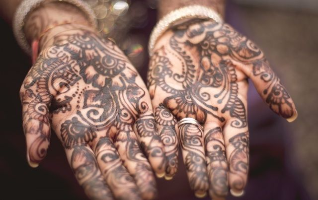 henna designs on two open hands