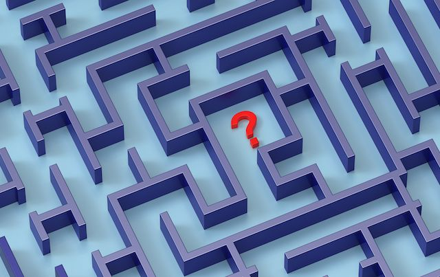 red question mark in center of blue maze