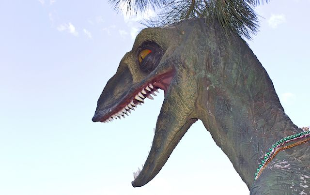 Head and neck of scary dinosaur statue