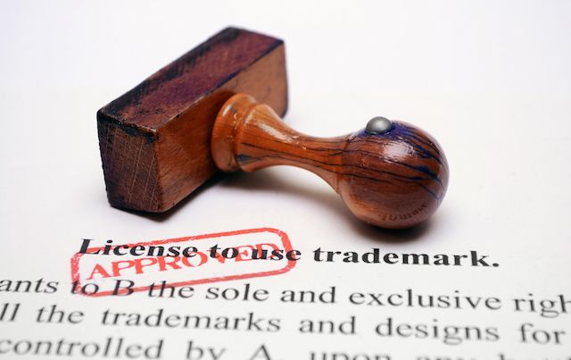 Rubber stamp says APPROVED on trademark license.
