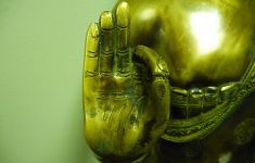hand of Buddha statue in mudra pose