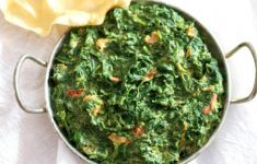 Indian creamed spinach Saag in steel pan