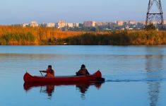 Kayakers canoeists in urban waterway