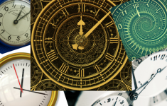 Overlapping images of various clock faces