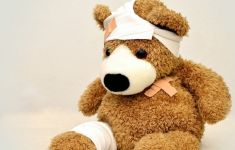 Teddy bear with bandages and plasters.