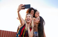 Group of four women posing for a selfie.