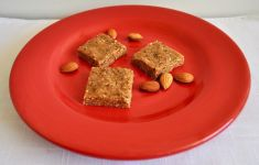 energy bars and almonds on red plate