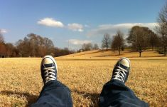 self portrait feet in Converse looking toward fields