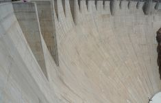 curved vertical cement wall of hydro dam
