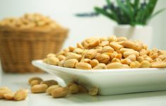 White dish filled with peanuts