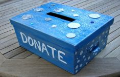 "blue homemade charity contribution box with ""DONATE"" printed on side"