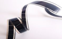 Strip of film coiled on white backdrop.