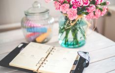 open calendar on desk with pink flowers