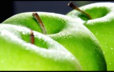 extreme close up on three green apples