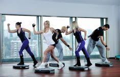 Group of women and men exercising indoors