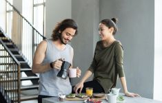 Man and woman in morning pouring coffee