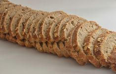 Sliced loaf of oat quick bread.