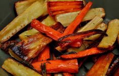 roasted carrots and parsnips on gray plate