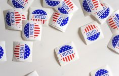 "Jumbled pile of ""I VOTED"" stickers"