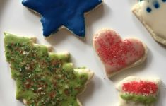 frosted gluten free holiday cookies on white plate