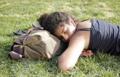 young woman asleep on lawn