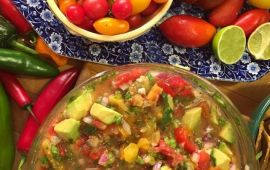 bowl of fresh summer salsa with ingredients tomatoes, peppers, lime