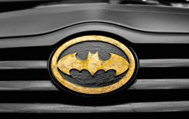 batman logo on front of black car