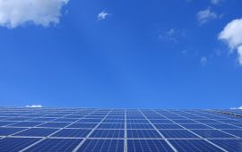 Solar panels reflecting deep blue sky
